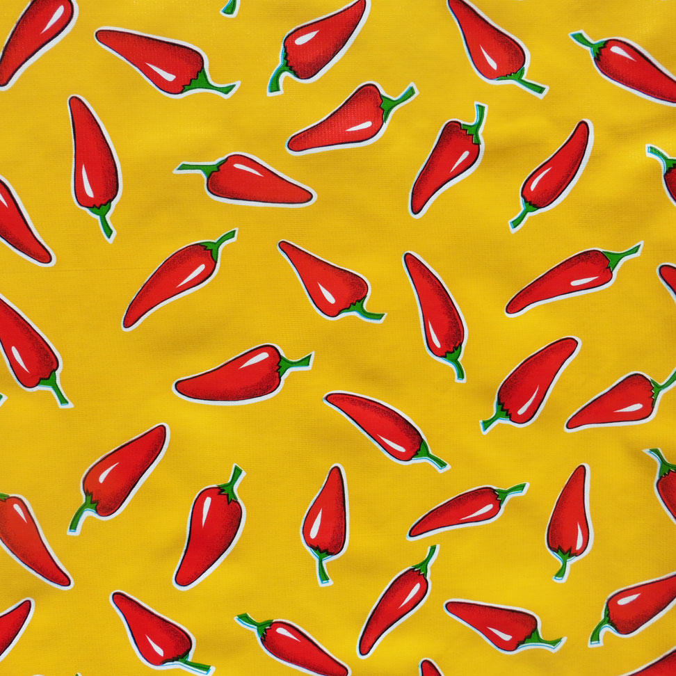 Red Chillies Pepper on yellow oil cloth