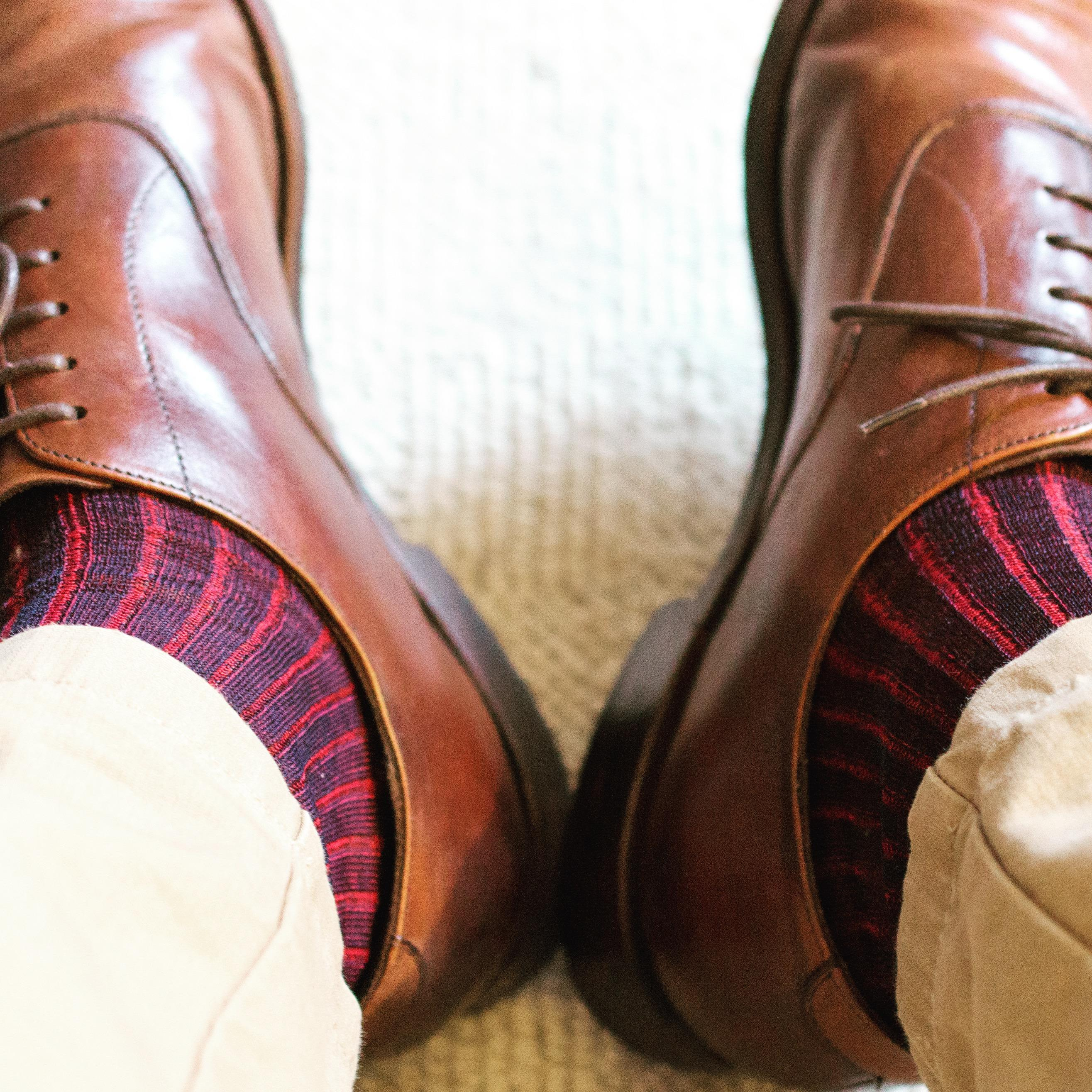 Bresciani socks with brown shoes and cream trousers