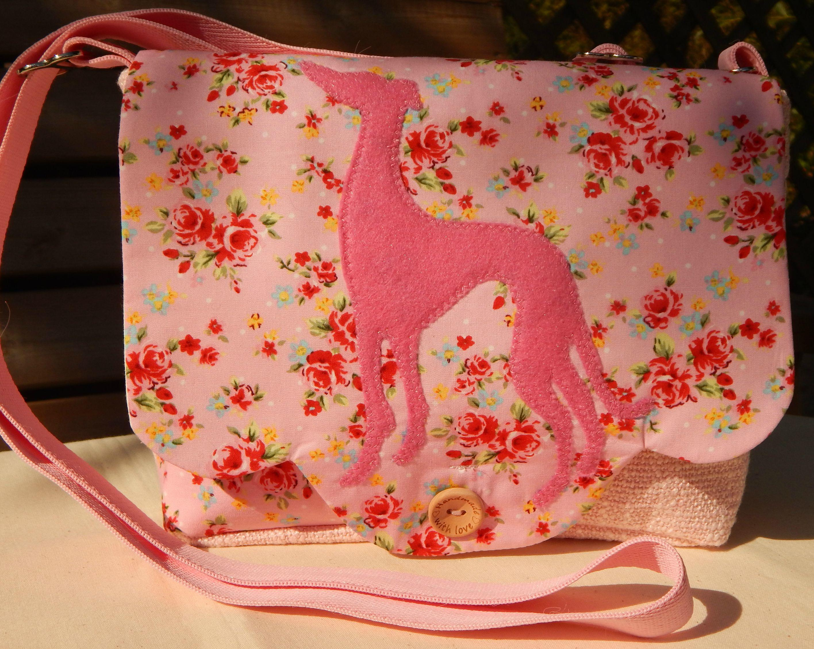 Small pink mini messenger bag with pink greyhound silhouette on the front