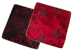 Computer mouse mats decorated with oriental patterns,