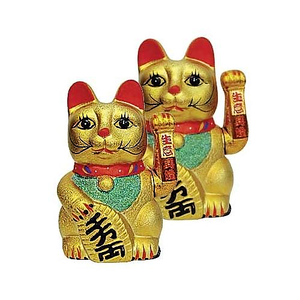Gold Chinese waving cats to bring luck and good fortune,