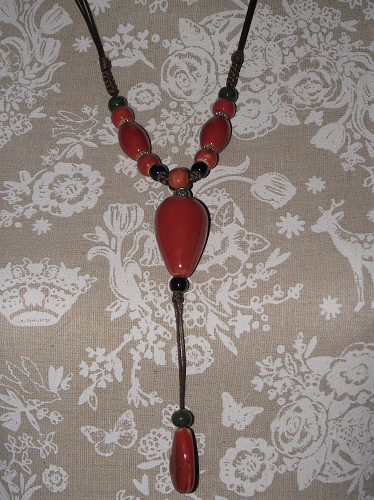 Ceramic bead necklaces with red strawberry shaped painted beads,