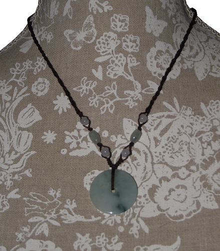 Jade bi-disc pendant with decorative green jade beads,