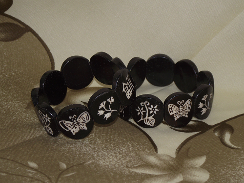 Chinese Ox bone bracelets with carved calligraphy symbols,