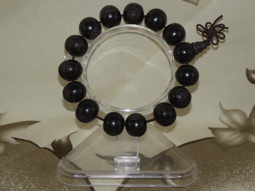 Chinese mala style ebony bracelets with carved Buddhist symbols,