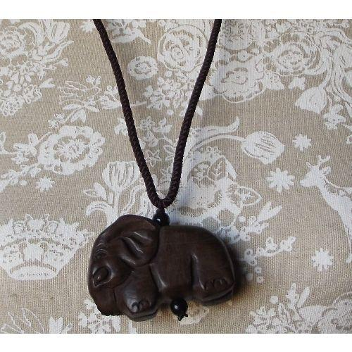 Feng Shui necklace with a carved wooden lucky elephant,