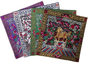 Embroidered Chinese table mats with mythical Kirin figures,