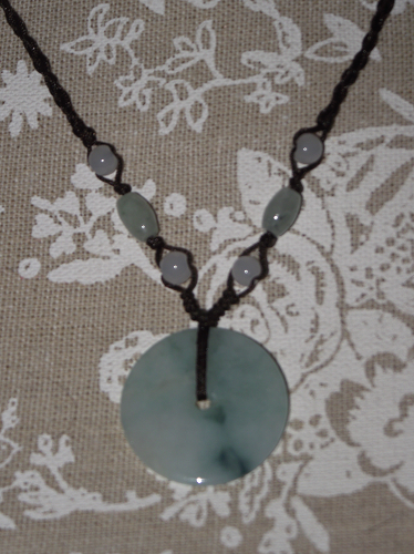 Green jade Chinese Bi-Disc pendant on a slipknot cord,