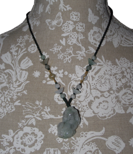 Jade Pixiu pendants on a Chinese slipknot cord,