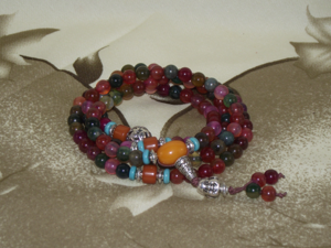 108 bead crystal Mala with a silver Buddha head,