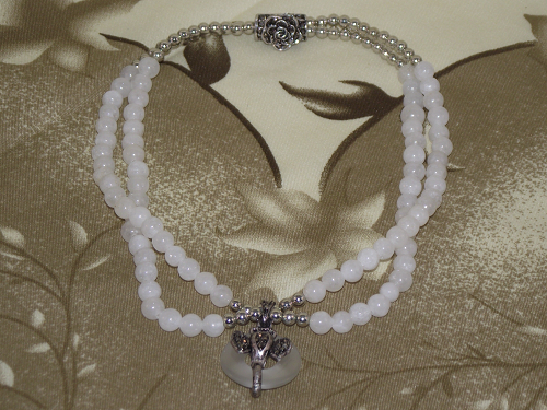 White crystal gemstone choker with a silver elephant,