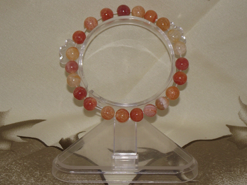 Stylish fashion bracelet strung with carnelian crystal gemstones,