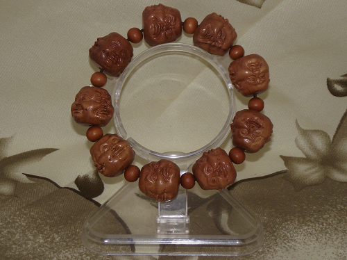 Wooden Buddha bracelets with four faces of Buddha heads,