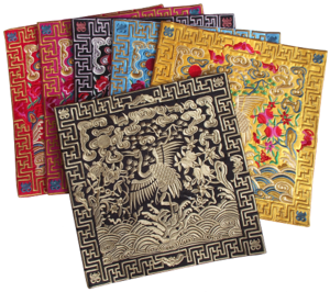 Assorted Chinese table mats with embroidered white Cranes,