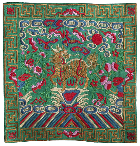 Green Chinese table mats with embroidered Kirin figures,