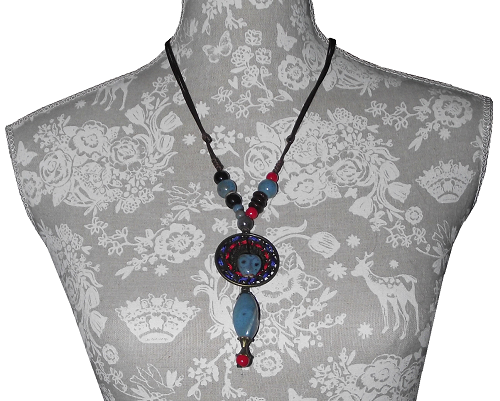 Ceramic bead necklace adorned with Tibetan style ornaments,