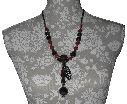 Fashion necklaces adorned with colourful painted ceramic beads,