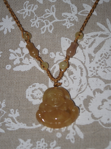 Yellow jade happy Buddha pendant with decorative beads,