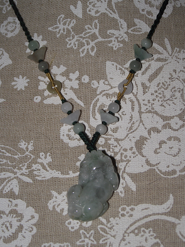 Green jade Pixiu pendant with decorative jade beads,