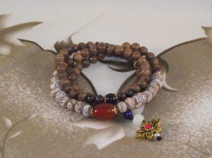Chinese bracelets with a lotus flower lucky charm,