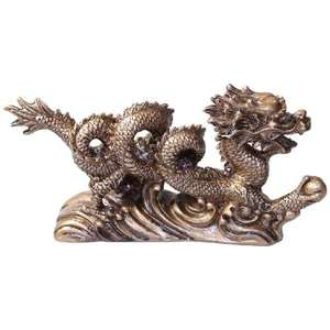 Gold Chinese dragon holding a prosperity pearl,