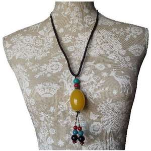 Chinese fashion necklace with a large amber colour bead,