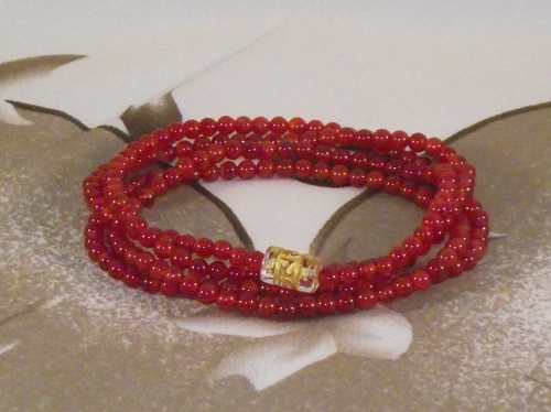 Red Carnelian wrist mala with a mantra bead,