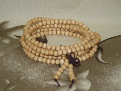 Buddha wrist mala made with ivory effect resin beads,