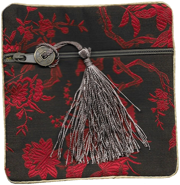 Chinese style silk purse with a lucky knotted coin tassel,