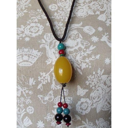 Chinese style fashion necklace with an amber resin bead,