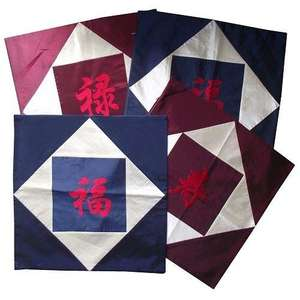 Chinese cushion covers with embroidered calligraphy symbols,