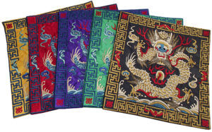 Chinese table mats with embroidered Chinese dragon patterns,