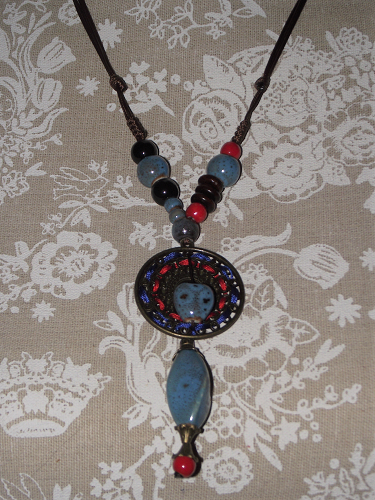 Tibetan style necklace on a traditional slipknot neck cord,