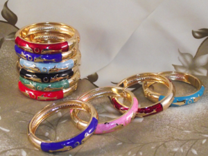 Fashion bangles decorated with gold dolphins,