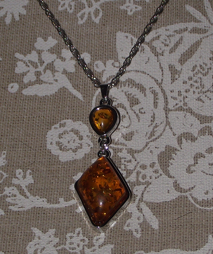 Imitation amber pendant on a silver colour fashion chain,