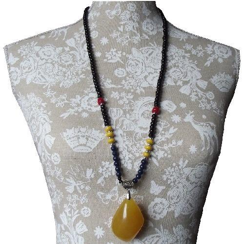 Chinese necklace with a large amber colour stone pendant,
