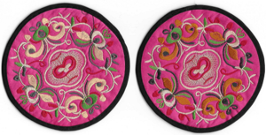 Pink Chinese style table mats with oriental patterns,