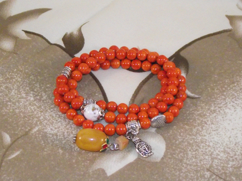 Chinese charm bracelets with Buddha's hand and citrus fruit,