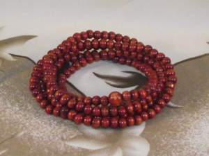 Chinese mala style bracelets with wood effect beads,