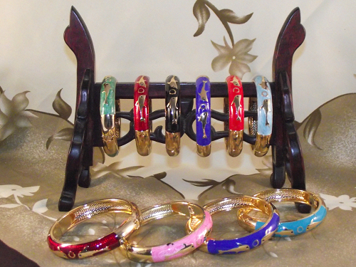 Colourful costume cuff bangles with golden dolphin patterns,