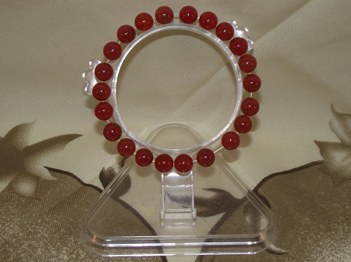 Fashion bracelets strung with red carnelian gemstones,