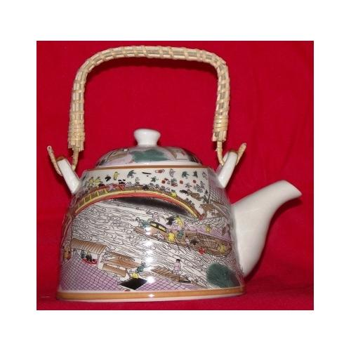 Chinese tea pot with a natural bamboo handle,