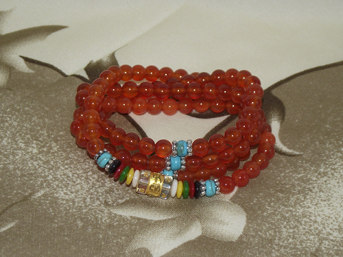 108 bead gemstone mala with red carnelian crystals,