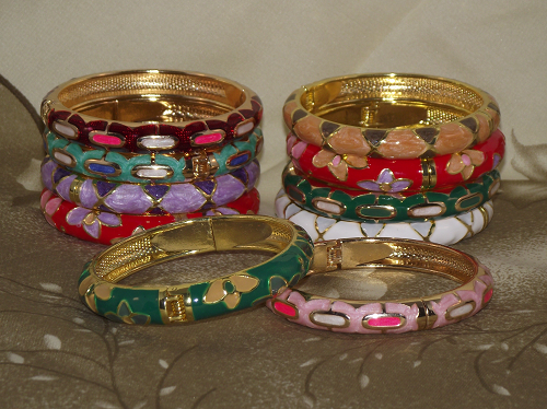 Closoinne bangles and bracelets with colourful floral patterns,