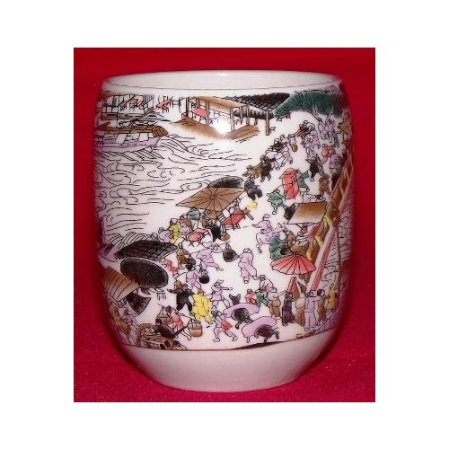 Chinese teacups decorated with painted oriental figures,
