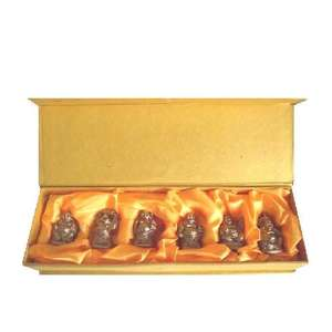 Set of six gold lucky buddha's in a presentation box,