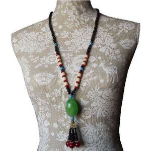 Tibetan style necklace with a large imitation jade bead,
