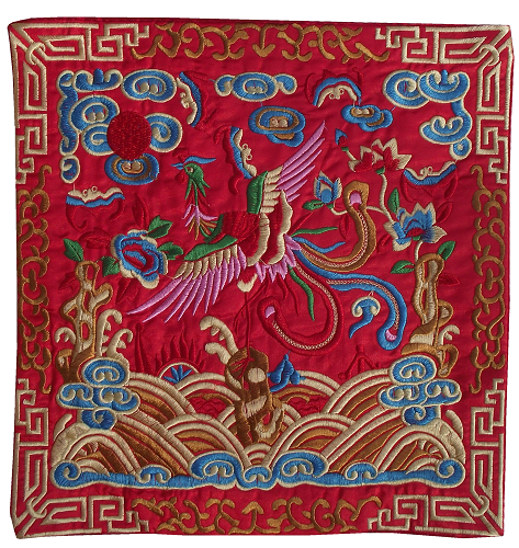 Red Chinese table mats with embroidered phoenix figures,