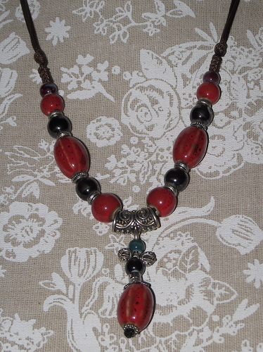 Hand painted ceramic bead necklaces with red and black beads,