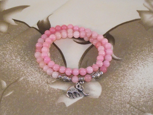 Chinese charm bracelet with pink crystals, and a silver elephant,